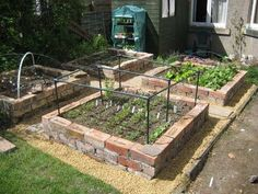 Brick Raised Beds, wish I had a pile (like a HUGE pile) of free salvaged bricks around to use for this!