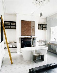 freestanding white bathtub in modern bathroom. / sfgirlbybay
