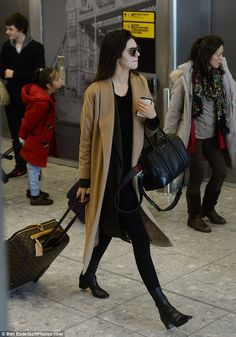 Showing what she's got! The 20-year-old showed off her lovely legs in her slim-fitting jet-set attire as she stalked through the terminal