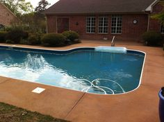 Stained Decorative Concrete Overlay Pool Deck in Conway, Arkansas.