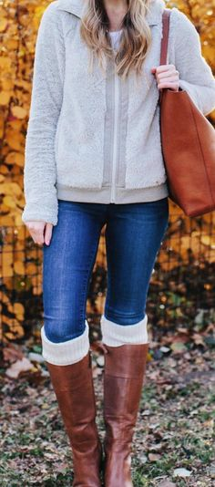 gray full-zip jacket and blue jeans