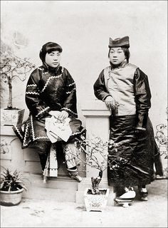 Chinese Couple (ca. 1905) This photograph was probably purchased by a german official or soldier in Tianjin, ca. 1905. Unidentified photographer. (two women dressed as a couple, see shoes)