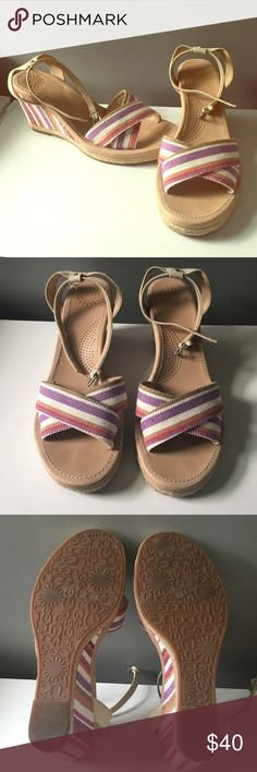 Ugg Australia Nyssa Stripe Wedges Barely worn, authentic Ugg Australia wedges. The stripes of gorgeous purple, magenta and neutral colors add something extra! There are few imperfections (shown in 4th photo) as these have been worn once. The ankle strap is also removable. UGG Shoes Wedges