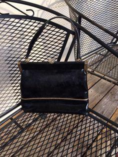 Vintage 1950s Black Patent Leather Naturalizer Handbag with gold trim  by NotJustOldVintage on Etsy https://www.etsy.com/listing/222763536/vintage-1950s-black-patent-leather
