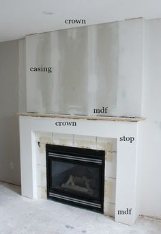 Fireplace Makeover PROGRESS - Get the details of this white and marble fireplace makeover, including adding trim and moulding to dress it up. The finished fireplace is beautiful! Reface Fireplace, Faux Fireplace Mantels, Fireplace Tile Surround, Linear Fireplace, Build A Fireplace, Brick Fireplace Makeover, White Fireplace, Rustic Fireplaces, Fireplace Hearth