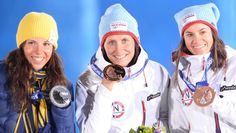 The three medalists in cross-country women's skiathlon, Sweden's Charlotte Kala (silver), Norway's Marit Bjoergen (gold) and Norway's Heidi Weng (bronze) pose for a picture after receiving their respective medals on Day 1 of the Sochi Olympics.