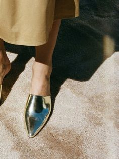 Add a metallic dose to your daily ensemble with golden mules.