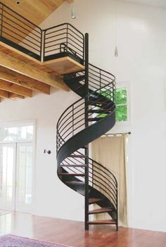 Spiral stairs, wood tread.
