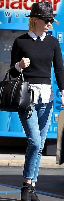 Who made January Jones' black handbag and blue skinny jeans that she wore in Los Angeles? Purse – Givenchy  Purse – Goldsign