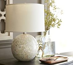 I am all about thst bling...lol Jolie Mother-of-Pearl Round Lamp Base #potterybarn