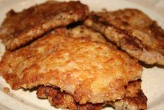 Pork Schnitzel from Deep South Dish website. Boneless pork chops, pounded thin, dredged in an egg wash and crushed saltines, pan fried and finished with a lemon and butter garlic sauce. Fried Boneless Pork Chops, Fried Pork Tenderloin, Thin Pork Chops, Pork Cutlets, Pork Tenderloin Recipes, Pork Cutlet Recipes, Schnitzel Recipes, Pork Chop Recipes, Skillet Recipes