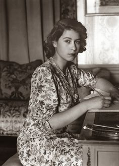 Queen Elizabeth II (as Princess Elizabeth) writing at her desk in Windsor Castle, Berkshire. (1944)