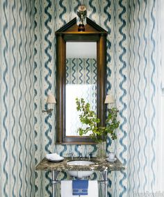 For some reason I love this tiny little powder room -- it's got to be the wallpaper   - Alex Hitz- HouseBeautiful.com