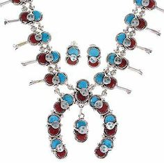 "Effie Calavaza Squash Blossom Coral Turquoise Zuni Snake Necklace Earring Set GS57770 SilverTribe. $1299.99. MEASUREMENTS: Necklace measures approximately 20-5/8"" inside circumference allowing the side links to measure 1/2"" long and 1-1/4"" wide, while the center piece measures 2-1/2"" long and 2-1/4"" at widest point. The necklace weighs 92 grams. Post earrings measure approximately 3/4"" long and 1/2"" at widest point.. MATERIALS: Sterling silver, Coral and Turquoise.. Sou..."