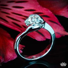 1/3 Beautiful and unique, this Custom Solitaire Engagement Ring is set in 14k White Gold and features two hands wrapping around a 0.508ct A CUT ABOVE® Hearts and Arrows Diamond.