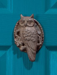 "Cast Iron Owl Doorknocker:  Day or night, the watchful owl waits to announce visitors at your door. Cast-iron knocker depicts an owl on a leafy branch. Antique rust finish. 6"" high x 3 5/8"" wide."