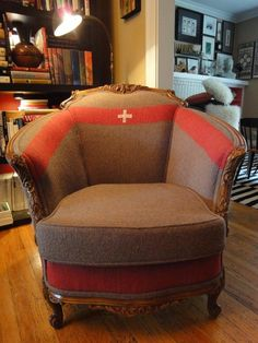 A gorgeous vintage chair, professionally upholstered in vintage Swiss Army blankets.  The chair is original wood/ finish, structurally sound with all new springs. Detailing includes cording aroun...