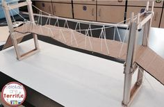 Let's build a suspension bridge using craft sticks and glue! Can you add string to make it resemble a rel suspension bridge? Stem Projects, Science Fair Projects, School Projects, Stem Classes, Engineering Design Process, Stem Steam, Stem Science, Science Experiments, Stem Challenges