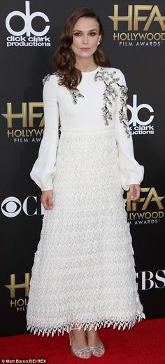 FLOOR-LENGTH AND FAB Nov 14: Hollywood Film Awards, LA. Giambattista Valli couture dress, £18,000, Rupert Sanderson sandals, £475. Verdict: When everyone stares at your stomach, divert them with a frock that costs more than a car. PRICE TAG: £18,475