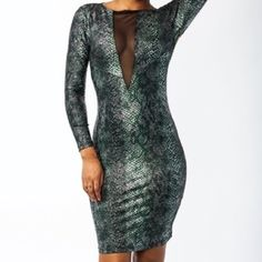 Faux Snakeskin Dress Very sexy party girl dress. Stretch material with a Deep mesh plunge in the front. No holes, No stains & Smoke Free. Excellent condition☺ Runs Small/Fits more like an XL than a 1X. (I'm 5'4/ 200 pounds) Dresses Midi