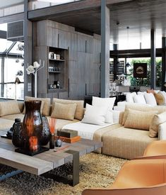 One amazing and sophisticated penthouse in Cape Town. The happy owners of the waterfront apartment, Karen and Richard Barrow, hired Cécile & Boyd's to decorate the place. The two sectionals are custom made pieces were used, the wood & metal coffee table along with the brass floors lamps and a couple of vases are the firm's own design. Love the