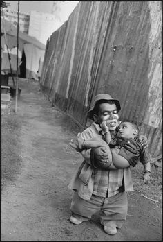 © Mary Ellen Mark, 'Usman Holding His Son', Jumbo Circus, Bombay, India, 1992. Photographer Mary Ellen Mark died in May, 2015, at 75 y/o.