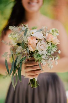 Bouquet with peach garden roses, white spray roses, Queen Anne's lace, ivory stock, and seeded eucalyptus. | Sharing my real October wedding with the Pinterest world. | Tyler Scott Photography (website: http://tylerscottphotography.com/)