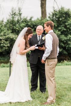 Photo of bride and groom exchanging vows on wedding day by Alysha Christine Photography
