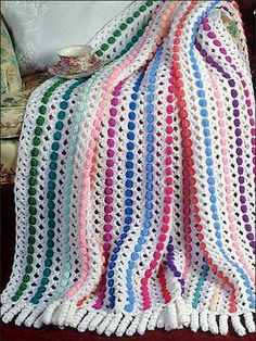 This one is just fun! I like all the colors and playfullness of it. It looks like polka dots, wich I love! (Katie would love this too I bet)Easy Ripple Afghan - Free Crochet Pattern - Handcrafting With Love