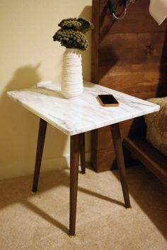 Solid 1 White Marble Side Table can be used by your bed or sofa. This table comes in two heights, 20 and 25 with a white marble top measuring 16 x The legs come in your choice of stain, Ebony, Red Mahogany or Dark Walnut with brass swivel glides. Furniture Factory, My Furniture, Marble Top, White Marble, Heng Long, Mid Century Modern Side Table, Living Room End Tables, Reclaimed Wood Furniture, Danish