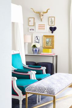 Club chairs, mums bench + gallery wall sitting area in master bedroom