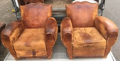 Antique French Leather Moustache club chairs - a pair. Free Delivery depending on your area.