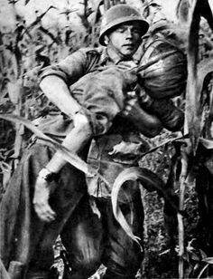 Slovak soldier carrying his friend out of the cornfield after he got hit by a Soviet bullet. Eastern Front Ww2, Military Diorama, Axis Powers, Armed Forces, World War Two, My Father, Troops, Wwii, Vietnam