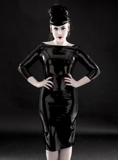 Mod 1960's style latex ensemble. Buy black latex material at: www.MJTrends.com