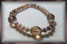 Hi Welcome to Jani's Handmadibles! Where handmade is made with love! My prices are affordable, and the quality is great! Hope to see you again soon! This bracelet is made with: 10mm Transparent brown