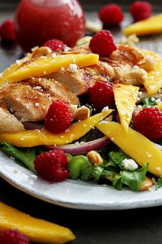 Fresh mangos, raspberries, juicy grilled chicken and candied cashew give this salad a huge burst of flavor! A quick and healthy meal in less than 30 minutes!