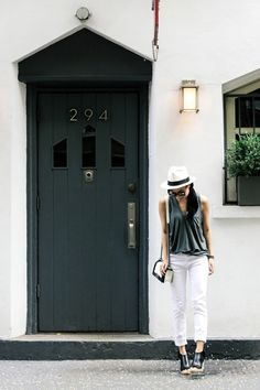 clogs with tank top and white jeans