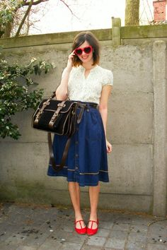 Love the skirt (piping!), the way the belt is tied, and those red t-straps.