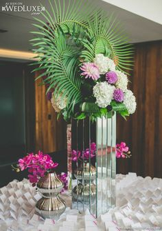 WedLuxe: large floral arrangement with tropical flowers