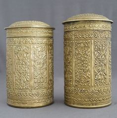 Catawiki online auction house: 2 large heavy canisters with floral relief scenery - Sumatra - Indonesia