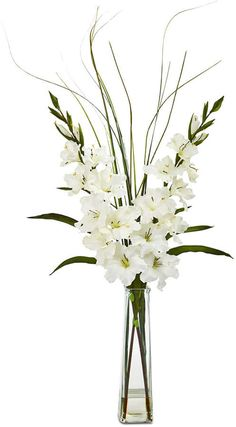 Lush and lifelike gladiolas, accented by leafy greenery, create the freshly-cut look and statuesque silhouette of this artificial arrangement from Nearly Natural. It comes elegantly displayed in a glass vase with a faux water line. Gladiolus Arrangements, Home Flower Arrangements, Artificial Floral Arrangements, Beautiful Flower Arrangements, Flower Vases, Cactus Flower, Funeral Floral Arrangements, Artificial Flowers, Home Flower Decor