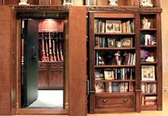 Vault - Hidden in a bookcase.  Must have a place to store the family jewels, guns, knives, works of art, backup hard drives with our photographs, stories, poems and music collection on them.