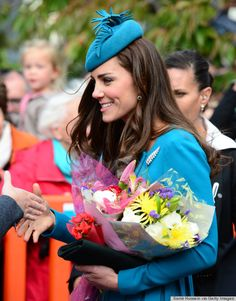Kate in blue with leaf brooch and leaf hat
