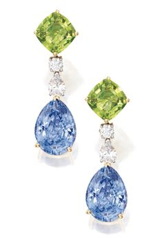 Pair of 18 Karat Gold, Platinum, Sapphire, Peridot and Diamond Earrings Set with two pear-shaped sapphires weighing approx 13.75 carats, accented by two cushion-cut peridots, further set with round and pear-shaped diamonds weighing approx .80 carat.