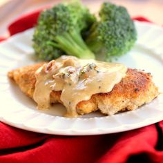 Chicken In Basil Cream Sauce: 1/2 cup milk   1/2 cup dried Italian bread crumbs   4 skinless, boneless chicken breasts   3 tablespoons butter   1 clove garlic (1/2 teaspoon minced)   1/2 cup chicken broth   1 cup heavy whipping cream   1/4 cup sun-dried tomatoes, chopped   1/2 cup grated Parmesan cheese   1/4 cup chopped fresh basil   1/8 teaspoon black pepper