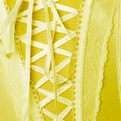 Yellow corset, beautiful with lace and ribbon.