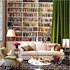My DREAM! a wall fulllllll of books with a comfy reading couch and some kind of cozy nook with a blanket