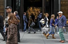 Pedestrians walk outside the Abercrombie & Fitch store on Fifth Avenue in New York, U.S., on Thursday, Feb. 12, 2009. Abercrombie & Fitch is scheduled to release quarterly earnings on Friday, Feb. 13, 2009.