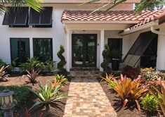 Beautiful Bahama Shutters enhance the curb appeal of this beautiful home. Bahama Shutters, Exterior Shutters, Shades Blinds, Mississippi, Curb Appeal, Window Treatments, Beautiful Homes, Beach House, Garage Doors