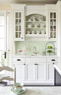 Beadboard Backsplash. Classic Oil Rubbed Bronze hardware. Molding. Glass Front Upper Cabinets. Simple Fronts. Display Shelf for China/Special Dishes. Corbels.